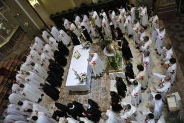 Templars praying during a night vigili